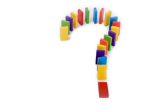 Question mark formed with colored lego pieces. Question mark with colored wooden dominos on a white background Royalty Free Stock Images