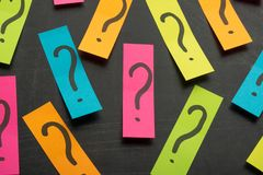 Question mark heap on table concept for confusion, question or solution royalty free stock images