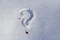 Question mark and heart in the snow. royalty free stock images