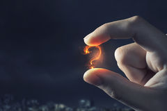 Question mark holden with fingers . Mixed media Royalty Free Stock Images