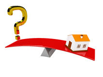 Question mark and the house on scales Royalty Free Stock Photography