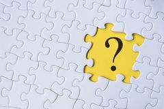Question mark on jigsaw puzzle with yellow background. Question, faq and q&a concept Royalty Free Stock Image