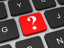 Question mark key on keyboard of laptop computer. Stock Photo