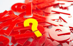 Question mark letter closeup. Find Question mark in yellow letters on a background of red letter in a jumble or word search puzzle Stock Photography