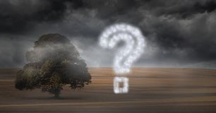 Question mark made of cloud texture by tree against storm clouds Royalty Free Stock Photography