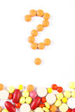 Question mark made of medical pills and tablets on white background, health care concept Royalty Free Stock Photo