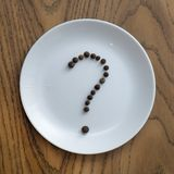 Question mark made of pepper stock images