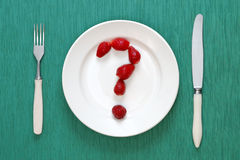Question mark made of strawberries Stock Image