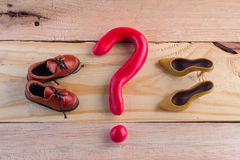 Question mark and men  girl shoe Royalty Free Stock Images