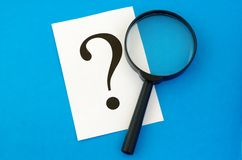 A question mark on the paper Stock Photography