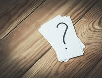 Question mark in paper on a wood background. Business concept Royalty Free Stock Image