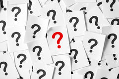 Question mark. Pile of question marks written on papers forming background royalty free stock images