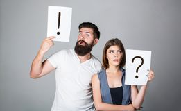Question mark. Quarrel between two people. Pensive man and a thoughtful woman. Husband and wife not talking, being in stock images