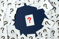 Question mark. Red question mark in the midst of the black on blue background Stock Images