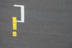 Question mark on road. Question mark painted in yellow and white on a road. Signifies the question on the future of transportation, cars and fuel Stock Photography