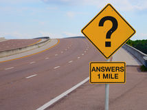 Question Mark Road Sign Answers 1 Mile to Success. Road sign with a big question mark on it with ANSWERS 1 MILE under the question mark signifying questions in royalty free stock photo