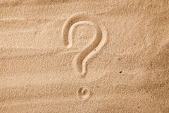 The question mark is sand painted on sand. Symbol of choice and doubt.  royalty free stock photography