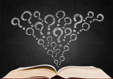 Question mark sign. On blackboard popup from book Stock Photo