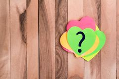 Question mark heart shaped note royalty free stock image