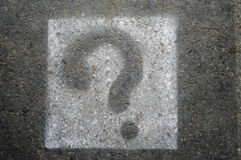 Question mark signs. Painted on a asphalt road surface Stock Images