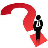 Question mark symbol business man search find. A business man stands on a question mark symbol to search find solution Stock Photography