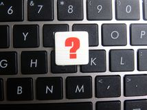 Question mark symbol on keyboard background. Question mark ? symbol on keyboard background Royalty Free Stock Photo