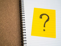 Question mark symbol on sticky note paper Stock Image