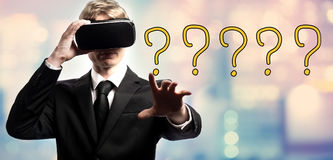 Question Mark text with businessman using a virtual reality Stock Image