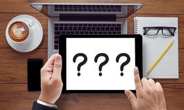 Question Mark  ??? What  Question Mark. On the tablet pc screen held by businessman hands - online, top view Royalty Free Stock Images