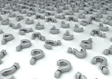 Question Marks. 3d image of a lot of chrome question marks on a white reflective floor Royalty Free Stock Image