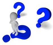 Question Marks Around Man Showing Confusion Stock Photos