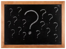 Question marks on blackboard Stock Images