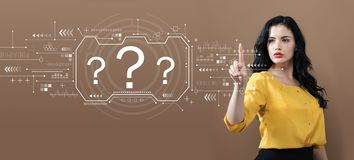 Question marks with business woman. On a brown background stock photo