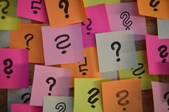 Question marks on colorful sticky notes stock image