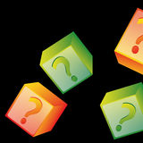 Question marks. Four colored boxes with question marks inside it in black background Royalty Free Stock Image
