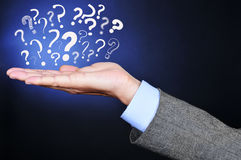 Question marks on the hand of a young man Royalty Free Stock Images