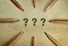 Question marks and pencils Stock Images
