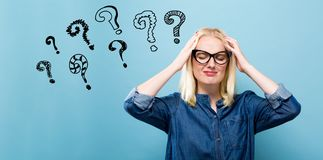 Question Marks with woman feeling stressed Stock Image
