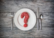 A question of meat, ground beef as a question mark.