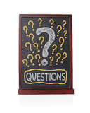 Question signs written on chalkboard Royalty Free Stock Photography