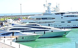 A question of size of mega yacht. Civitavecchia rome italy Mega yacht in port dock stock image