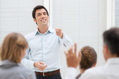 Question time at presentation. Business consultant answering a question during a meeting at office Stock Photos
