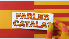Question to people, do you speak Catalan, illustration. Spain and Catalonia flag. stock footage