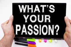 Question What Is Your Passion text written on tablet, computer in the office with marker, pen, stationery. Business concept for Go Royalty Free Stock Photography