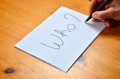 Question Who ?. Writing on white paper with black ink the word who royalty free stock images