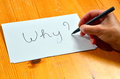 Question Why ?. Writing on white paper with black ink the word why Royalty Free Stock Photos