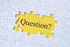 Question word on jigsaw puzzle with yellow background. Questions, faq, q&a, business concept Stock Images