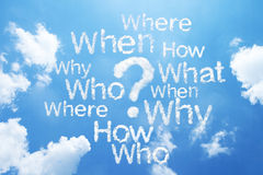 Question word and marks on sky Royalty Free Stock Photos