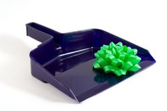 Questionable Gift. A green bow on a dustpan royalty free stock image