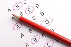 Questionario con la matita rossa Fotografie Stock Libere da Diritti
